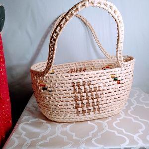 Woven medium sized basket grass?